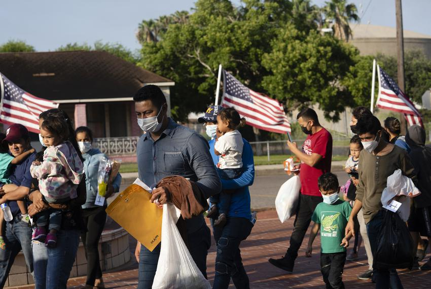 Asylum seekers walk to Our Lady of Guadalupe Catholic Church in Mission during a procession led by Father Roy Snipes on Aug.…