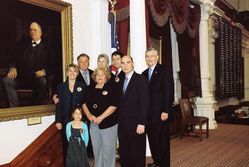 State Rep. Bonnen, R-Angleton, with the family of Jessica and Chaney Phillips on the House Floor in 2006. When the Phillip...