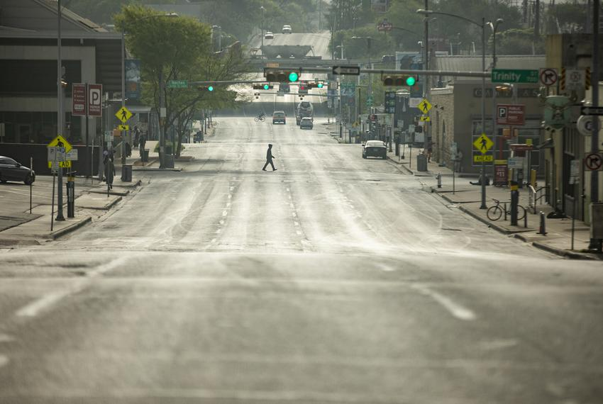 An empty Seventh Street during morning rush hour in Downtown Austin. The city's streets were mostly empty as a result of the…
