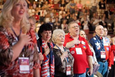 Texas Republican Convention attendees stand for the Pledge of Allegiance in Fort Worth.