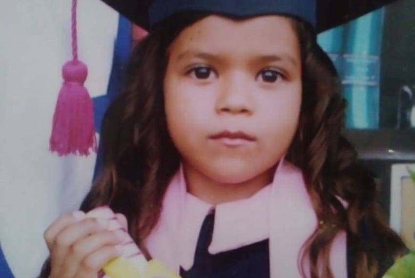"""Six-year-old Heyli at her kindergarten graduation. She was sobbing uncontrollably in a recent video call with her mother. """"I never imagined this,"""