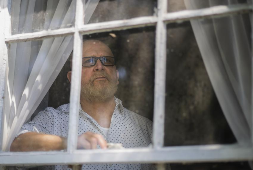 Tomas Garcia looks out of his home in Houston on Sept. 8, 2021.