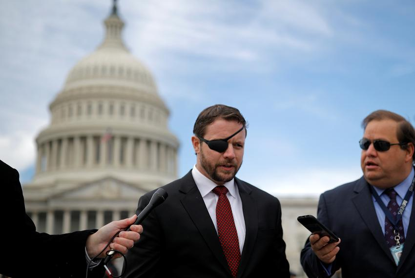 U.S. Rep. Dan Crenshaw, R-Houston, speaks with reporters as he arrives for a class photo with incoming newly elected members…