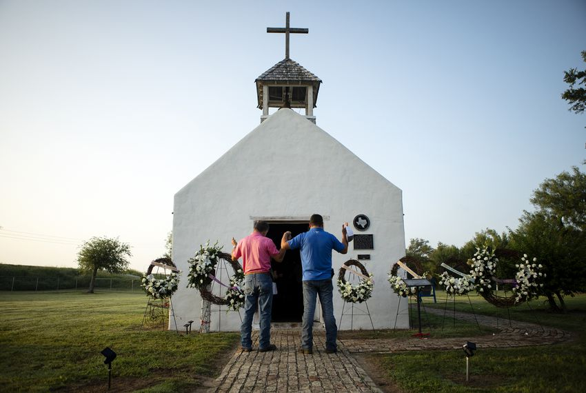 At the historic La Lomita Chapel in Mission, Rio Grande Valley residents held an early morning vigil Friday for migrants who drowned attempting to cross the Rio Grande.