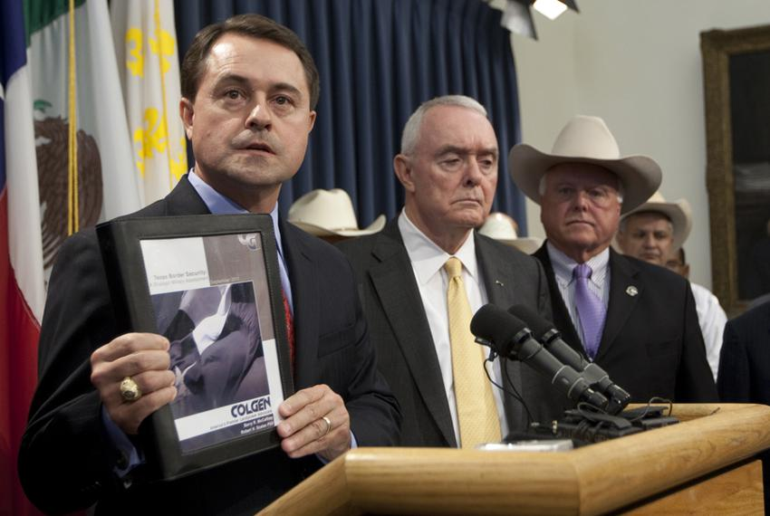 Texas Department of Agriculture Commissioner Todd Staples, holds up copy of recently released independent copy of Texas bord…