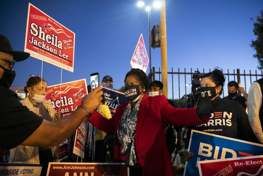 Congresswoman Sheila Jackson Lee, center, joins the family of George Floyd in cheering on Biden supporters outside of the Me…