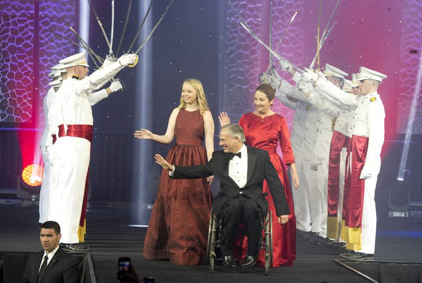 Abbott leads his family through the Ross Volunteers at the Inaugural Ball.