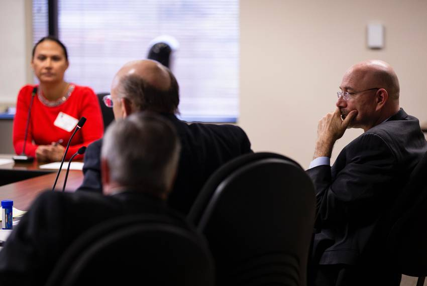 Michael Feinberg, right, sits with his lawyers, Christopher L. Tritico, left, and Ron S. Rainey while former KIPP employee...