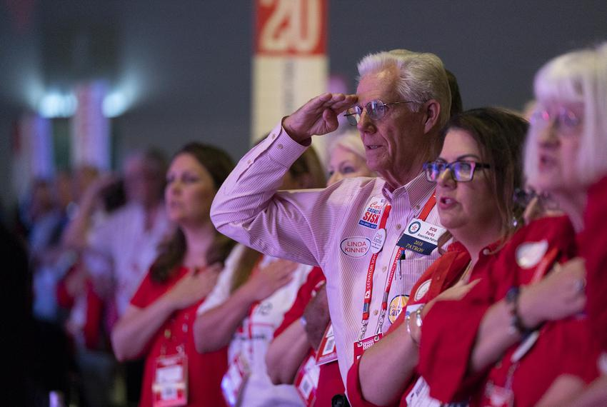 Bob Parks salutes the flag from the front row on the first day of the Republican Party of Texas convention in San Antonio on…