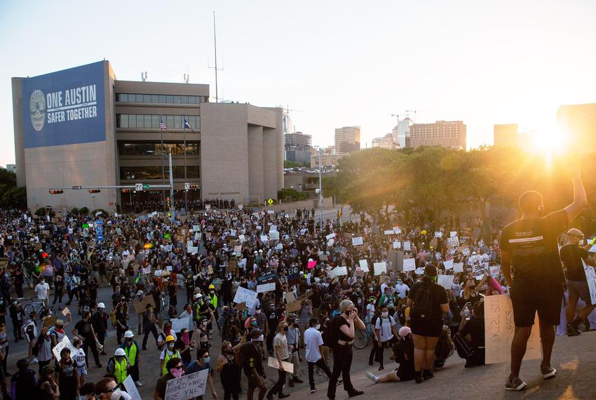 Demonstrators gather outside Austin Police headquarters for another night of protest against police violence towards people …