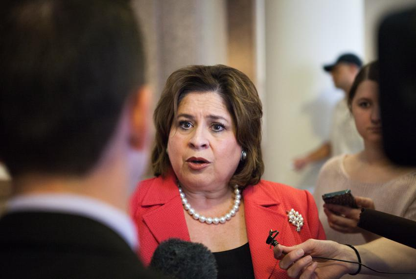 State Sen. Leticia Van de Putte, D-San Antonio, addresses a large crowd of abortion rights advocates who gathered Thursday...