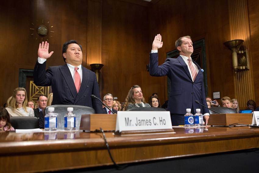 Texas nominees to the 5th Circuit Court of Appeals James C. Ho (left) and Don R. Willett are sworn in during a U.S. Senate Judiciary Committee confirmation hearing on Capitol Hill in Washington, D.C., on Nov. 15, 2017.