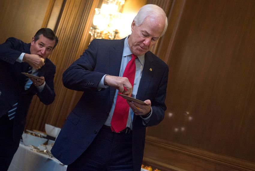 Senate Majority Whip John Cornyn, R-Texas, right, and Sen. Ted Cruz, R-Texas, sample Arkansas Cheese Dip and Texas Queso during a contest in the Capitol between the two states, December 07, 2016.