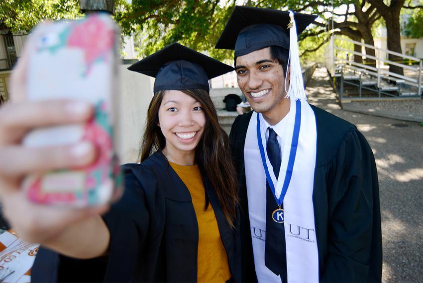University of Texas at Austin economics majors Alexis Guevara and Ahmed Quadri capture a graduation day moment for posteri...