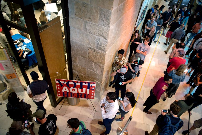 Voter wait in line at Austin City Hall to cast their ballots on Nov. 5, 2019.