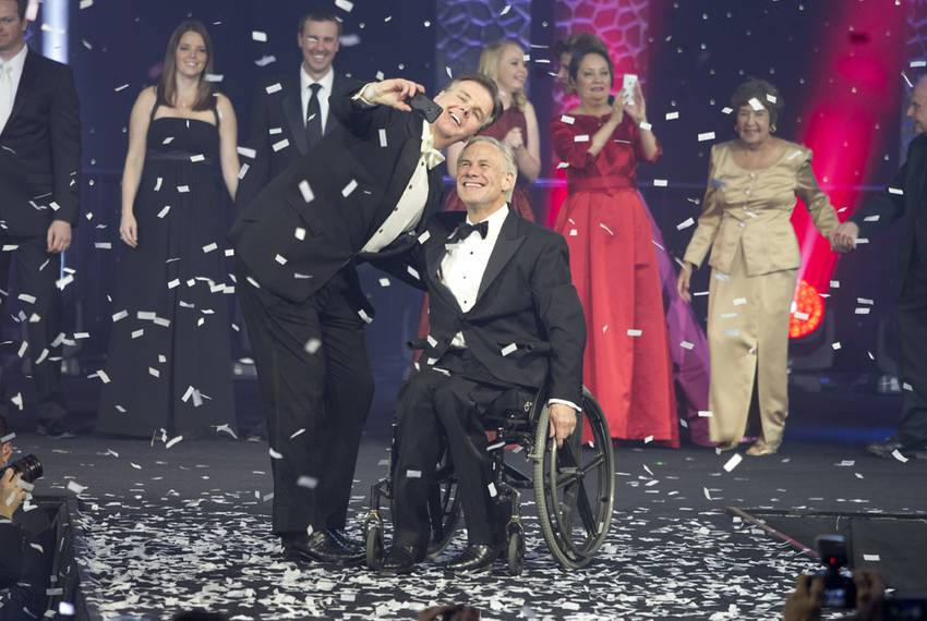 Gov. Greg Abbott and Lt. Gov. Dan Patrick pose for a selfie onstage at the 2015 Texas Inaugural Ball on Jan. 20, 2015.