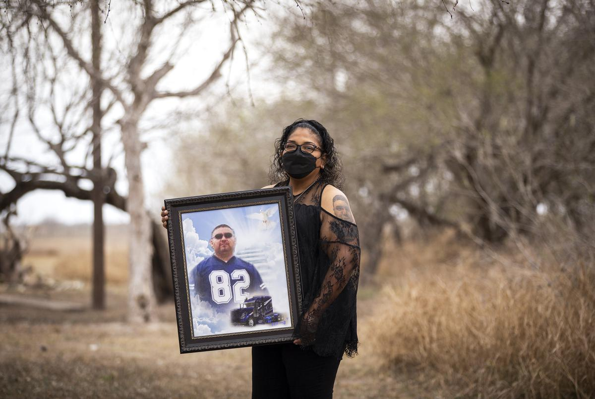 Ana Flores holds a framed photo of her husband Andres Arguelles in Brownsville on March 7, 2021.