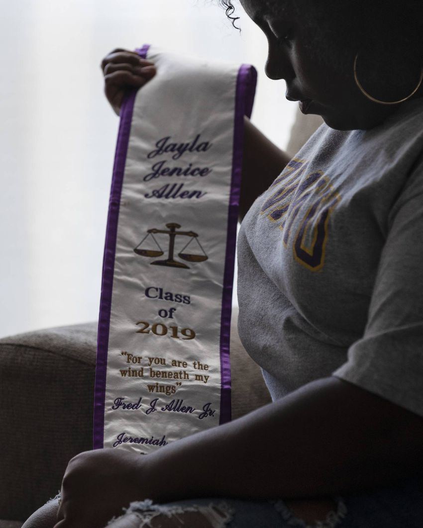 Prairie View A&M University graduate Jayla Allen, 22, holds her graduation stole with her grandfather's name embroiled on it…