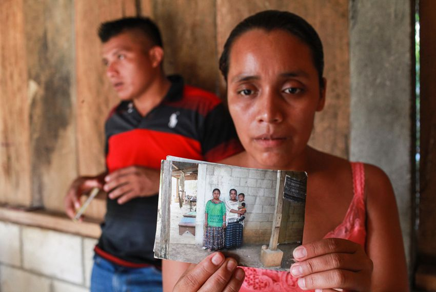 Florinda Bol holds a picture of her son Byron, who is in a shelter in Baytown, a thousand miles from their Guatemalan village.