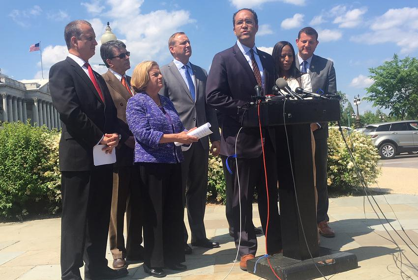 U.S. Rep Will Hurd, R-Helotes, center, speaks to reporters about an effort to force a debate on immigration legislation in t…