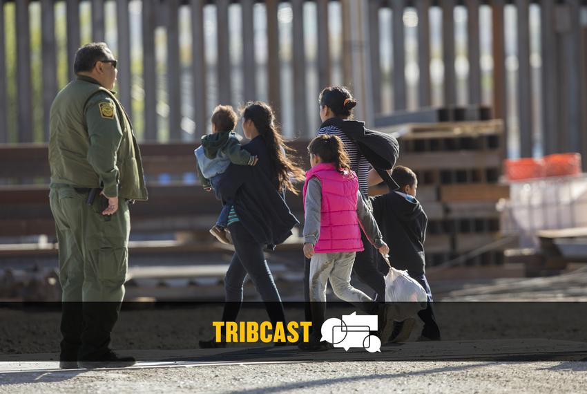 A migrant group is detained by Customs and Border Protection near the Paso del Norte International Bridge in El Paso on Marc…