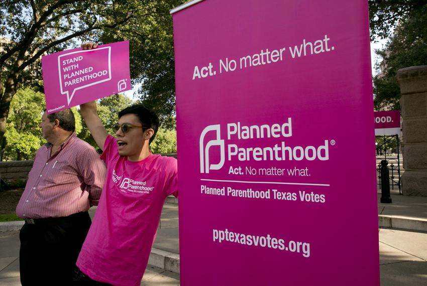 Group of Planned Parenthood supporters outside the Texas Capitol on July 29, 2015 on the morning when the Senate Committee o…