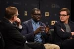 Texas Tribune CEO Evan Smith (left) hosts a community forum on race and justice, featuring Jamelle Bouie (center) and Chris Hayes, at The Texas Tribune Festival on Sept. 22, 2017.