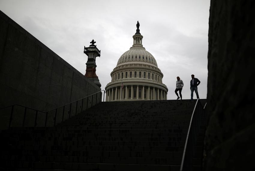 Pedestrians walk along the East Front of the U.S. Capitol Building on Capitol Hill in Washington, U.S. on Dec. 4, 2020.