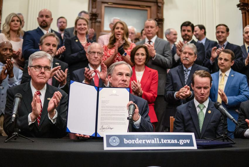 Flanked by Lt. Gov. Dan Patrick and House Speaker Dade Phelan, Gov. Greg Abbott held a press conference at the Capitol to pr…
