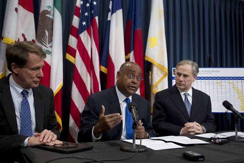 Sen. Rodney Ellis, D-Houston, c, discusses SB 1292 on pre-trial DNA testing March 19, 2013 with Sen. Robert Duncan, l, and Attorney Gen. Greg Abbott.