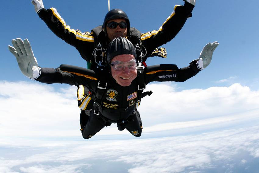 Former U.S. President George H.W. Bush celebrates his 85th birthday by jumping with the Army's Golden Knight parachute tea...