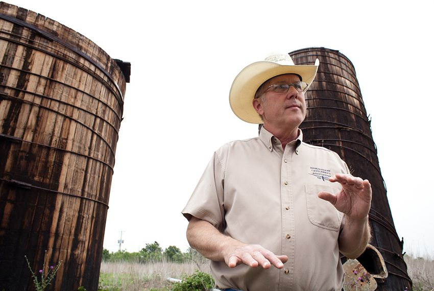 Landowner Stuart Carter, in Central Texas near the town of Luling, has years of abandoned oil equipment on his property. Here, two oil wooden oil tanks that he says date to the 1920s.
