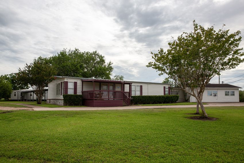 The Shiloh Treatment Center, near Manvel, is one of 32 Texas facilities licensed to care for migrant children who have been separated from their parents. The facility, where inspectors have found eight recent health and safety violations, has received $25 million in federal payments since 2013.