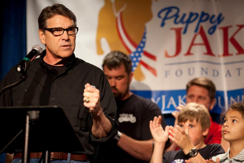 Former Gov. Rick Perry speaks to an audience of veterans and supporters at a fundraiser for the Puppy Jake Foundation in Iow…
