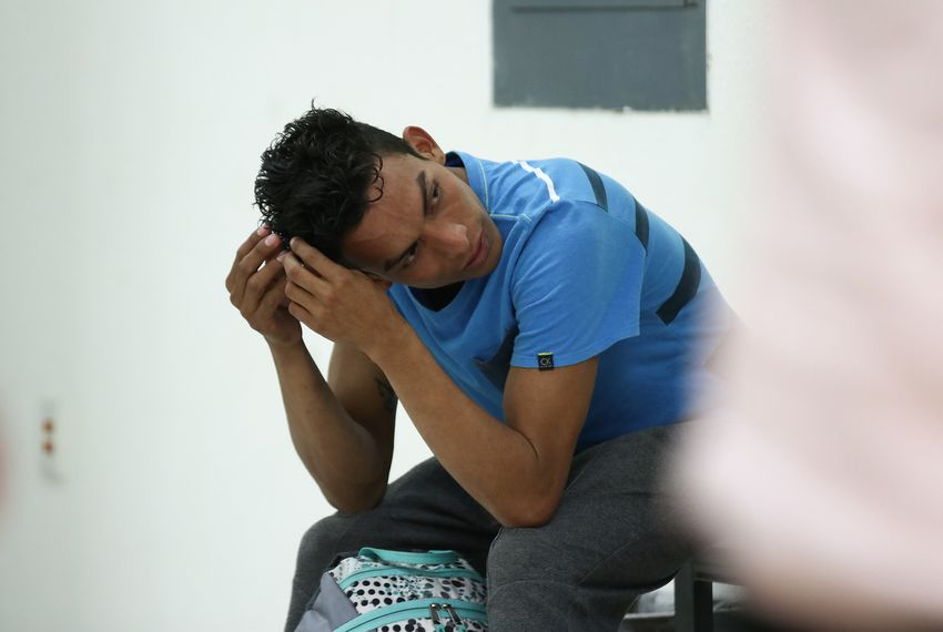 Misael Acosta waits at Ciudad Juárez's Centro de Atención a Migrantes after being returned to the Mexican border city.