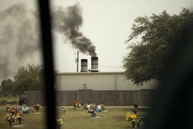 Smoke billows out of a smoke stack at the crematorium at Val Verde Memorial Gardens in Donna. July 17, 2020.