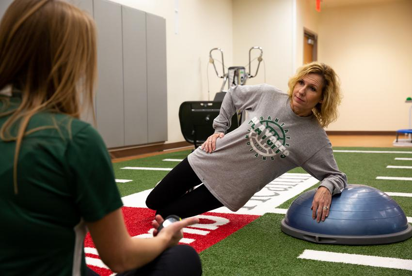 Flo Rice does modified planks on a Bosu ball with her physical therapist Katherine Saalfeld at UTMB Health. After being sh...