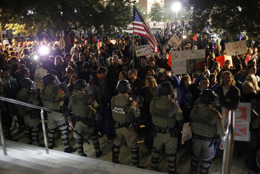 State police in riot gear face protesters at Texas A&M during white nationalist Richard Spencer's visit on December 6, 2016.