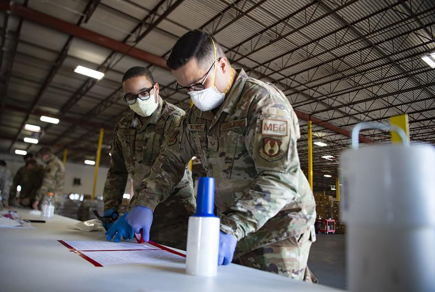 Staff Sgt. Noel Melendez and Senior Airman Jesse Moore, Air National Guard members with the 149th Fighter Wing, serve the ...