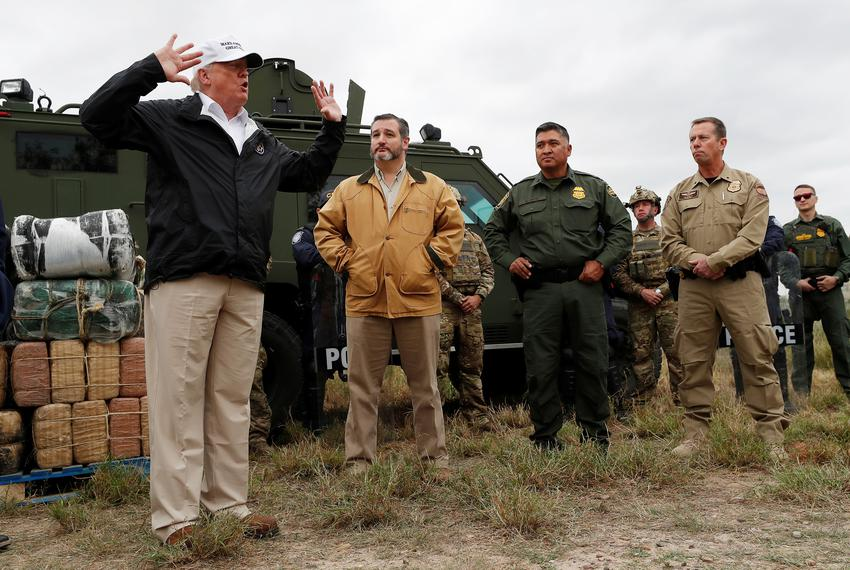 President Donald Trump speaks to reporters as he visits the banks of the Rio Grande River with U.S. Sen. Ted Cruz and U.S....