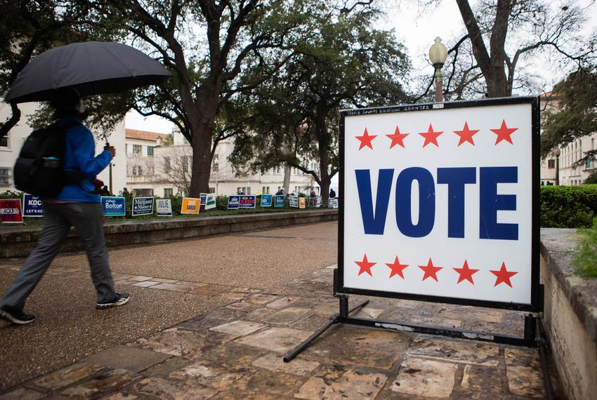 Voting signs at The University of Texas at Austin campus.
