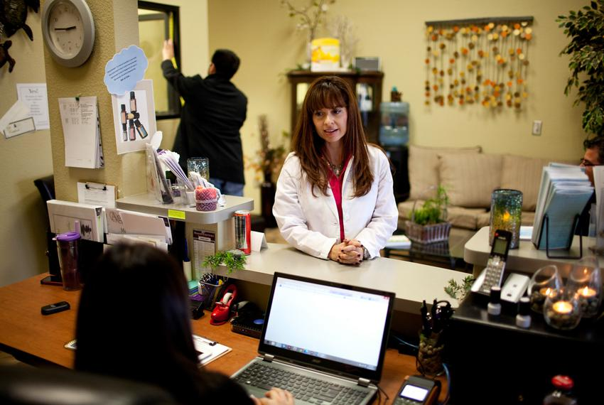 Nurse practitioner Christina Blanco speaks to the office manager at her medical spa and clinic in Las Cruces, N.M. on Saturd…