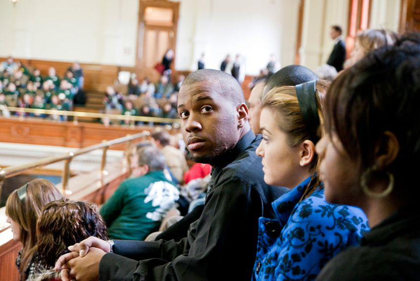 Brandon Demings sits in the Senate gallery on Community College Day at the Texas Capitol. He says students at Kilgore College are already feeling the pinch of state budget cuts.