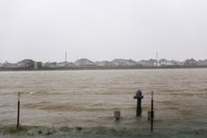 Floodwaters threaten the Grand Vista neighborhood in Richmond on Aug. 28, 2017. Residents were forced to evacuate due rising water from the Brazos River.