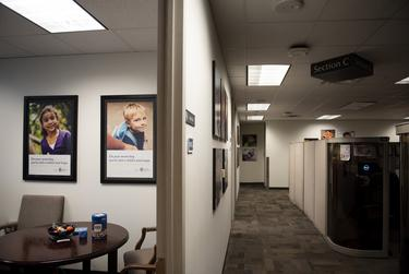 Heart Galleries, portraits of adoptable children, on display at the Child Protective Services office at the Texas Department of Family and Protective Services in Austin on Nov. 14, 2019.