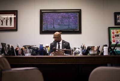 Paul Quinn College President Michael Sorrell takes a call in his office on Nov. 11 2019.