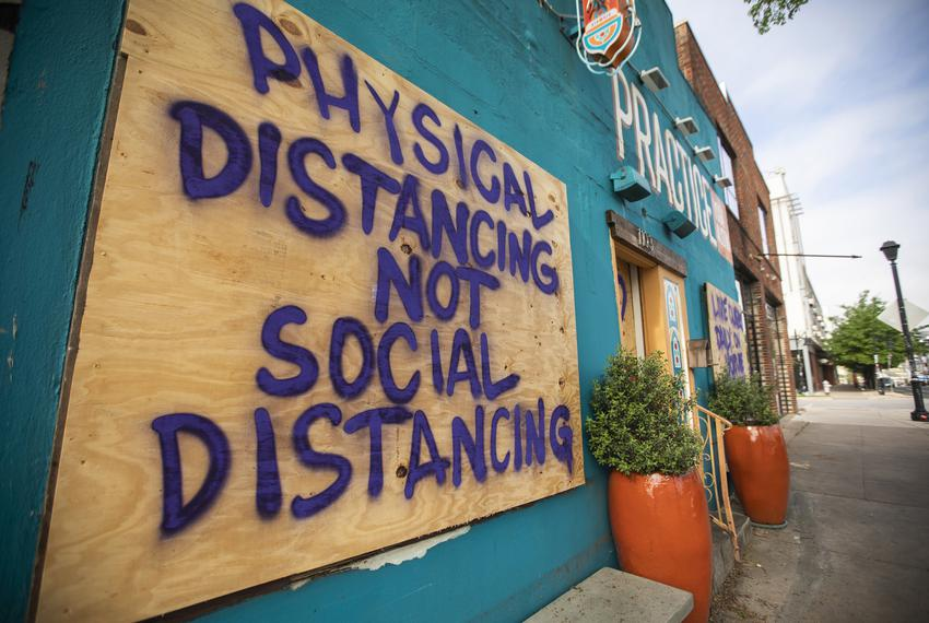 A spray painted sign at Practice Yoga Austin in East Austin refers to the recent coronavirus outbreak that has impacted th...