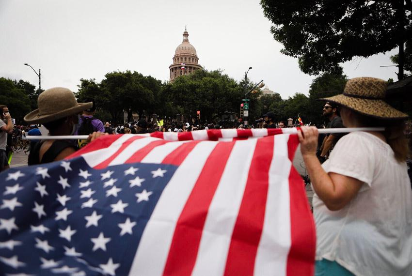 Protesters gather south of the Capitol building in Austin on Sunday, May 31, 2020.