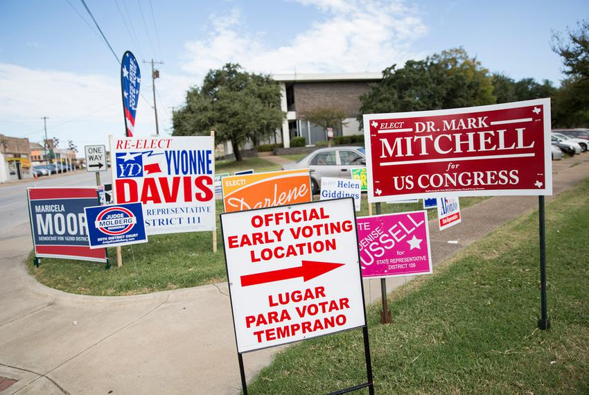 Signs line the property of the Oak Cliff Sub-Courthouse in Dallas, Texas, on the first day of early voting on Monday, Oct. 2…