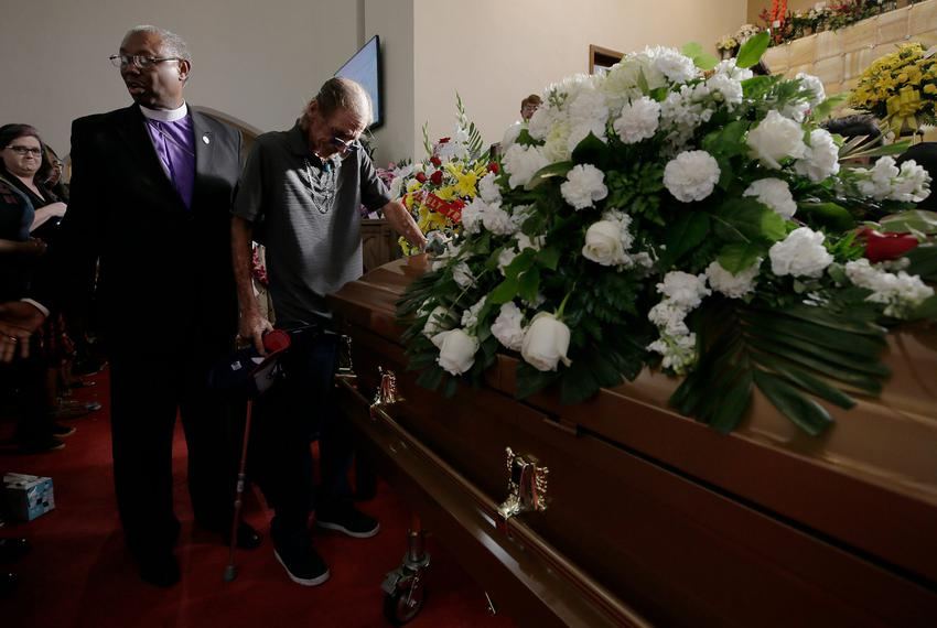 Antonio Basco places his hand on his wife Margie Reckard        s casket during her funeral at La Paz Faith Center in El Pas…